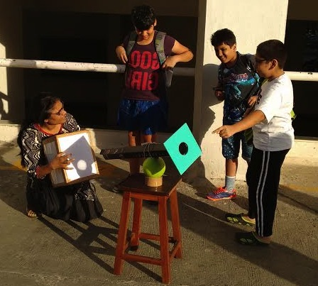 A group observing the Sun by means of projection